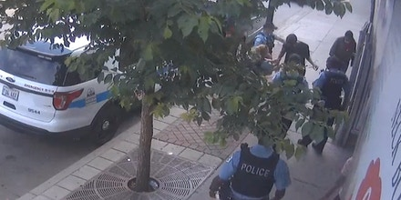 Still from a newly released third-party CCTV video, showing Chicago police approaching Harith Augustus.