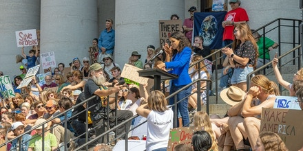 Morgan Harper gives a speech on the steps of the Ohio Statehouse at the Columbus Climate Strike on Sept. 20, 2019.