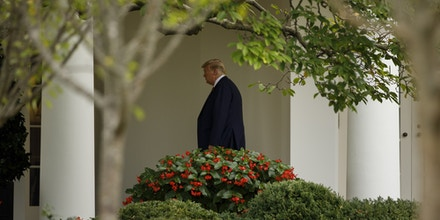 FILE - In this Thursday, Sept. 26, 2019, file photo President Donald Trump walks to the Oval Office of the White House in Washington as he returns from attending the United Nations General Assembly in New York. Trump mentioned a long-discredited conspiracy theory in his July phone call with Ukraine's leader. The theory tries to cast doubt on Russia's role in the 2016 hacking of Democratic email. Experts say that raises questions about Trump's ability to distinguish implausible claims from intelligence analysis and further burdens a public already deluged with disinformation. (AP Photo/Carolyn Kaster, File)