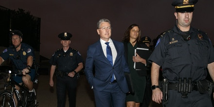 Kurt Volker, center, a former special envoy to Ukraine, is escorted as he leaves a closed-door interview with House investigators at the Capitol, Thursday, Oct. 3, 2019, in Washington. (AP Photo/Jacquelyn Martin)