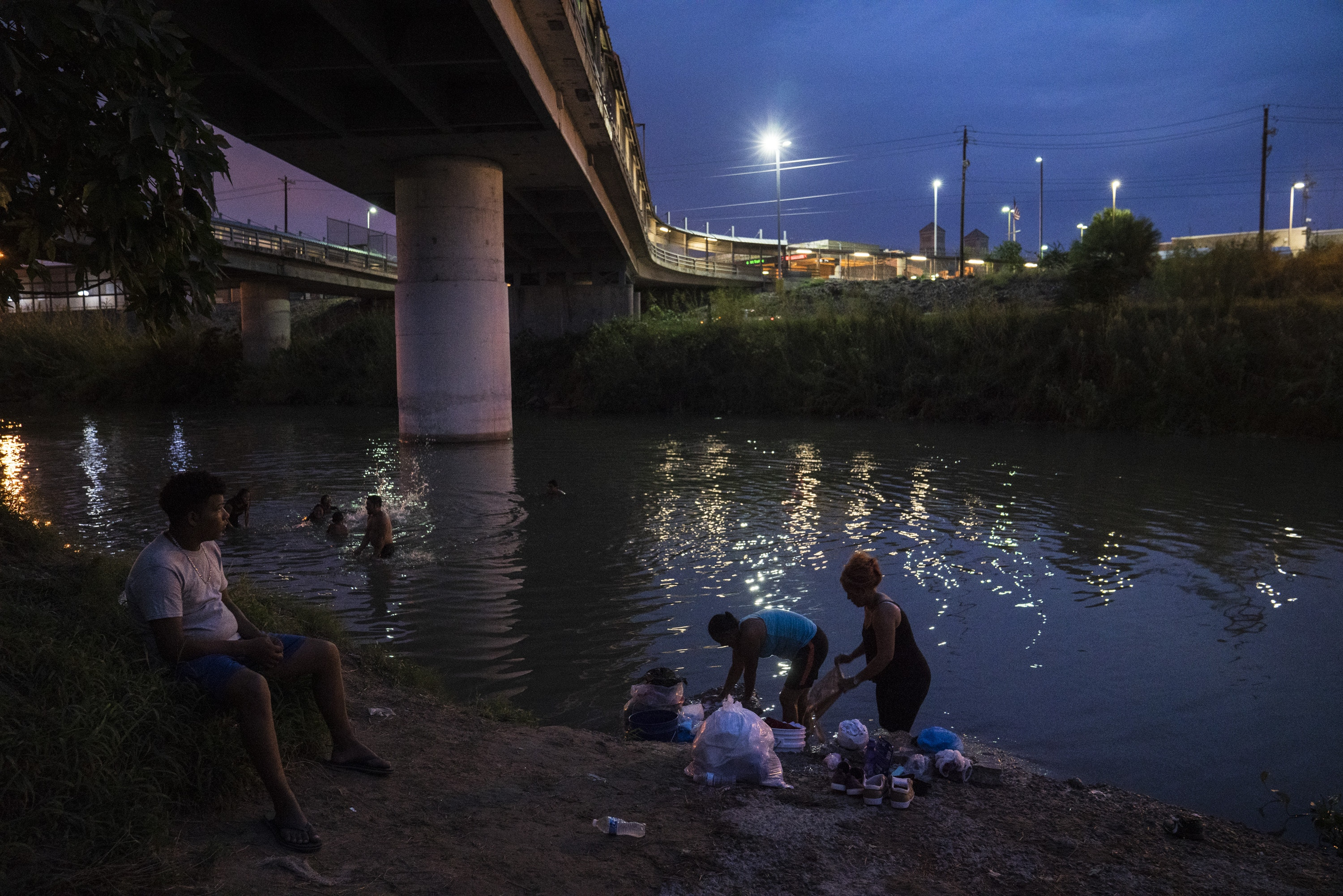The Gateway International Bridge as seen on Oct. 21, 2019 in Matamoros, Mexico. Many of the asylum seekers that live in the nearby encampment shower and wash their clothes in the Rio Grande.Verónica G. Cárdenas for The Intercept