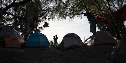 "An encampment where most of the people that live there have been sent back under the Migrant Protection Protocols, MPP, also referred to as ""Remain in Mexico"" program, is seen near the Gateway International Bridge on Oct. 22, 2019 in Matamoros, Mexico. Mexican authorities estimate that more than 1,000 asylum seekers live there.Verónica G. Cárdenas for The Intercept"