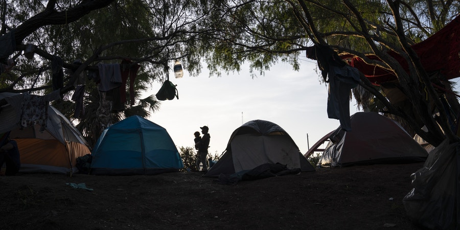 """An encampment where most of the people that live there have been sent back under the Migrant Protection Protocols, MPP, also referred to as """"Remain in Mexico"""" program, is seen near the Gateway International Bridge on Oct. 22, 2019 in Matamoros, Mexico. Mexican authorities estimate that more than 1,000 asylum seekers live there.Verónica G. Cárdenas for The Intercept"""