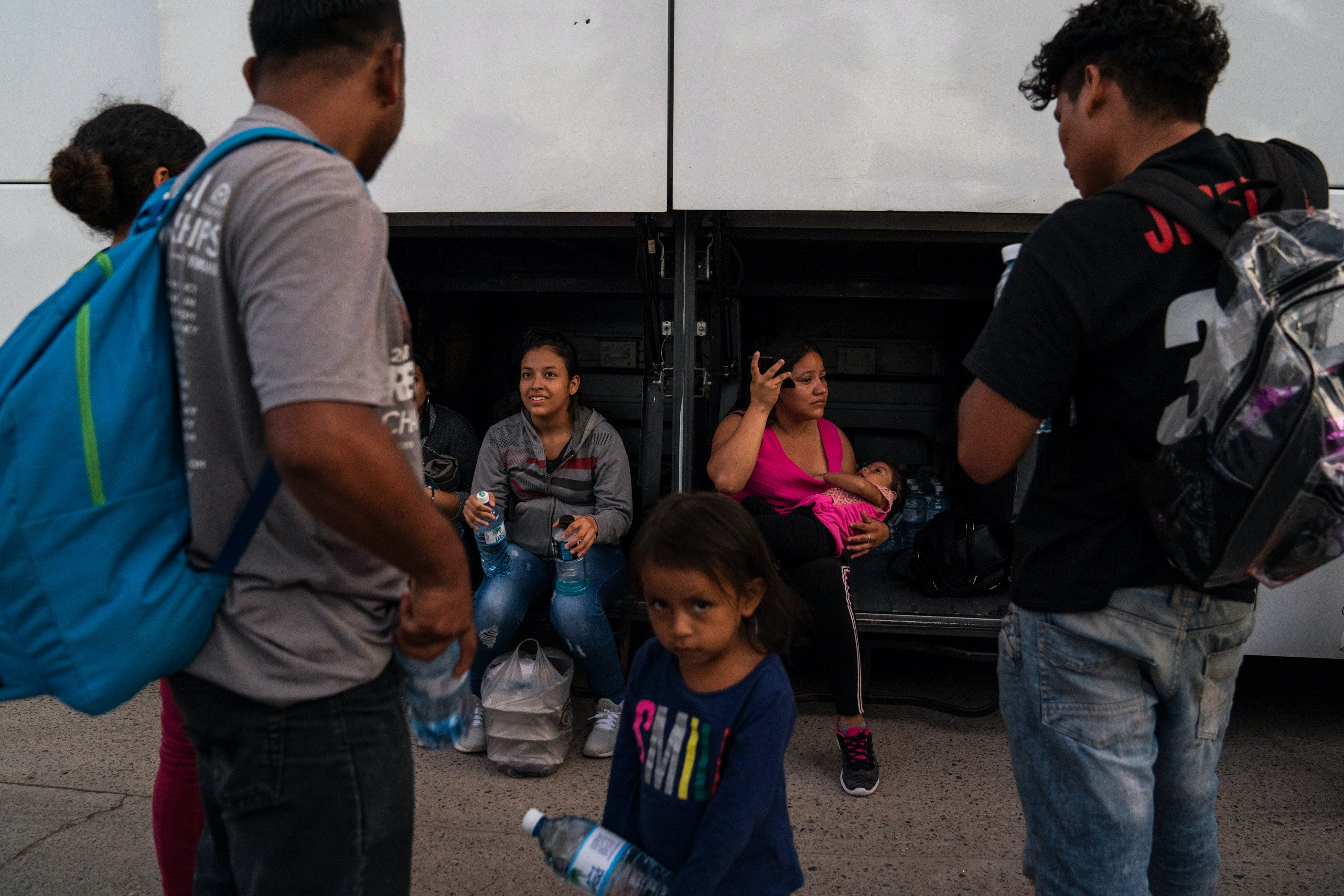 "Asylum seekers that were sent back under the Migrant Protection Protocols, MPP, also referred to as ""Remain in Mexico"" program, wait to board a bus that will take them to Tapachula, Chiapas, border with Guatemala on Oct. 22, 2019 in Matamoros, Mexico.Verónica G. Cárdenas for The Intercept"