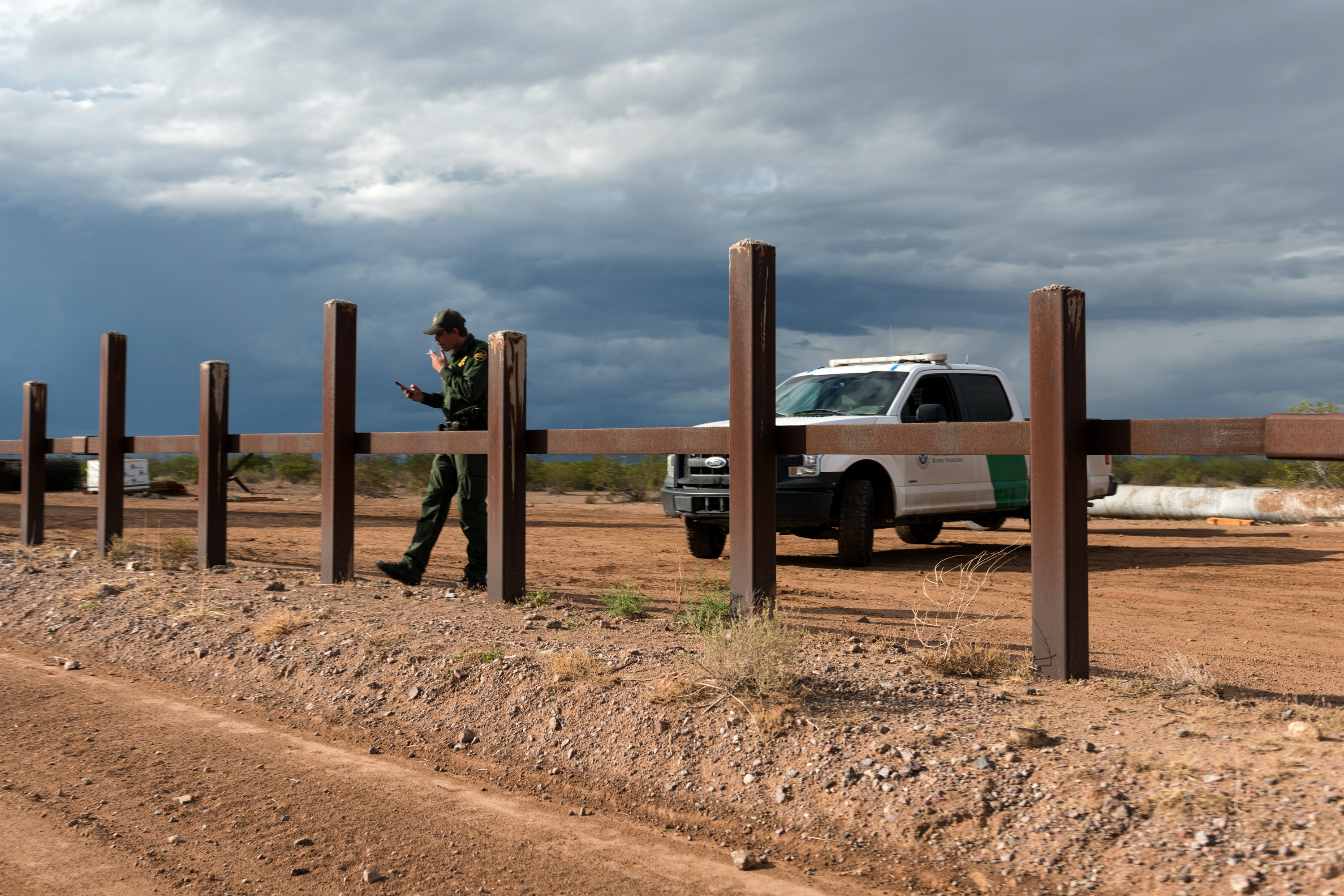Lukeville, Ariz. September 26, 2019: A CBP officer observes and reports on Laiken Jordahl's movement from across the border to the east of Lukeville, Ariz. on Thursday September 26, 2019. (Ash Ponders for The Intercept)
