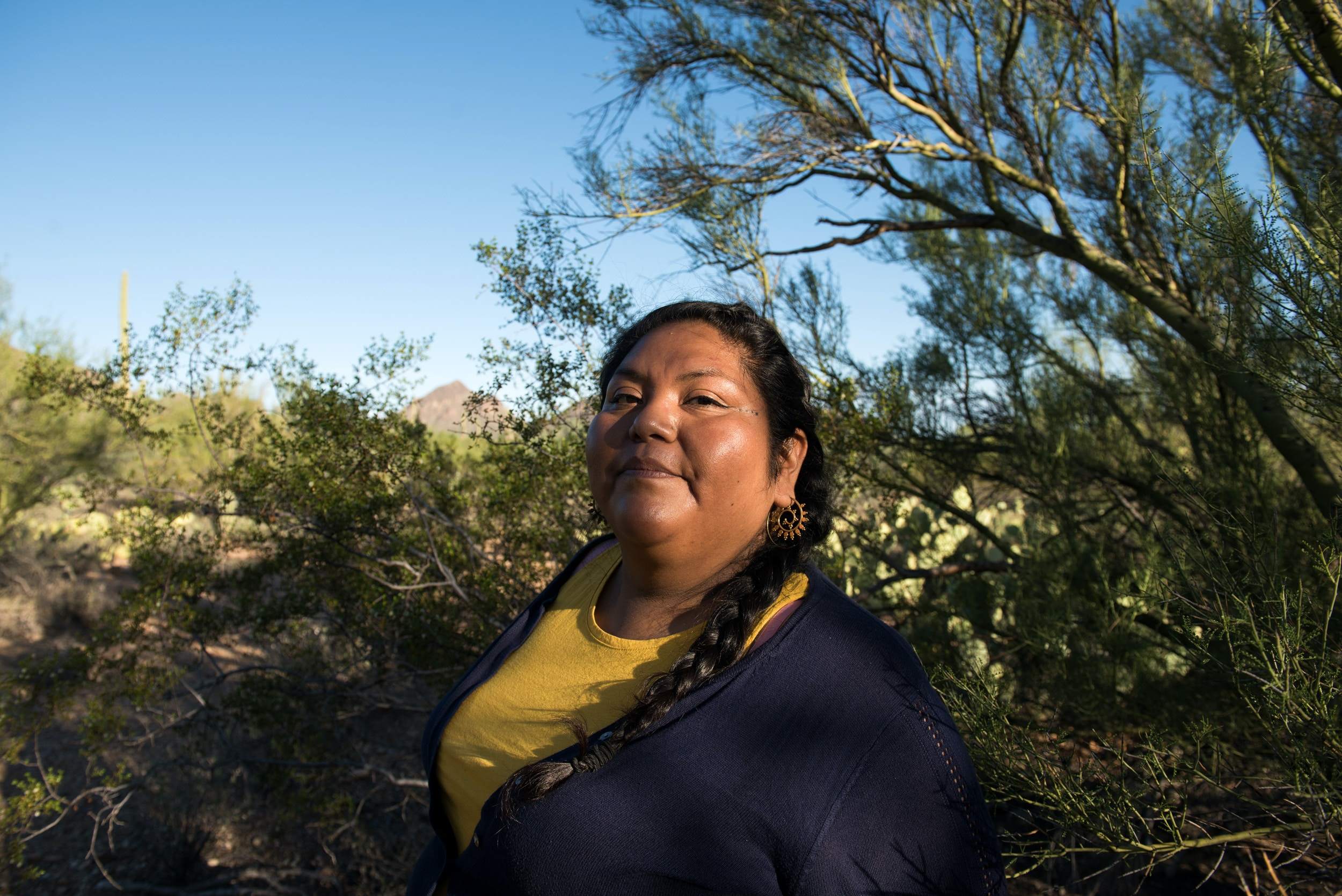 Tucson, Ariz. October 1, 2019: Amy Juan amid the desert flora of Saguaro National Park in Tucson, Ariz. on Tuesday October 1, 2019. (Ash Ponders for the The Intercept)
