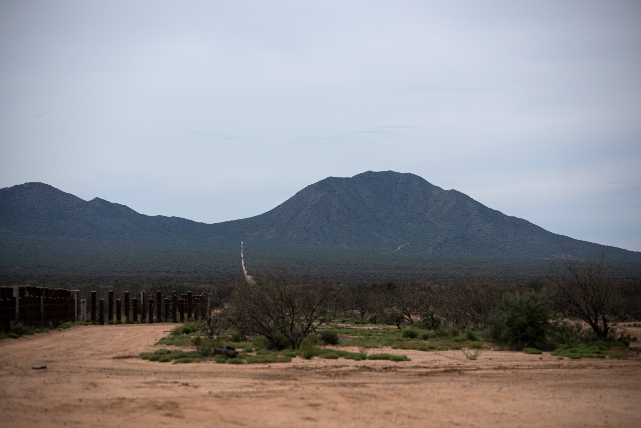 Sells, Ariz. March 27, 2019: Small anti-vehicle bollards trace the US border that bisects the Tohono O'odham nation just south of Sells, Ariz. on Wednesday March 27, 2019. (Ash Ponders for The Intercept)