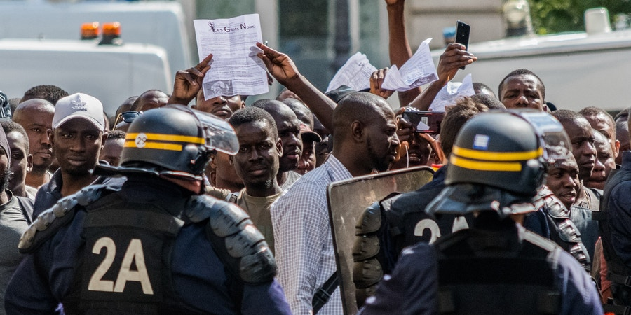 Hundreds of undocumented migrants calling themselves black vests  (gilets noirs) stormed the Pantheon monument in central Paris on July 12, 2019 demanding the right to remain in France. (Photo by Estelle Ruiz/NurPhoto via Getty Images)