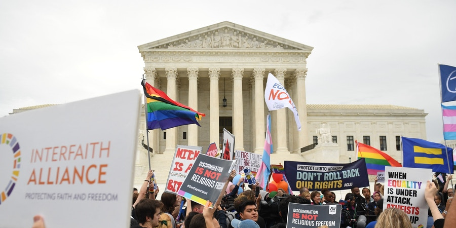 Demonstrators in favor of LGBT rights rally outside the US Supreme Court in Washington, DC, October 8, 2019, as the Court holds oral arguments in three cases dealing with workplace discrimination based on sexual orientation. (Photo by SAUL LOEB / AFP) (Photo by SAUL LOEB/AFP via Getty Images)