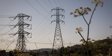Electrical power polls stand outside of Novato, California, U.S., on Wednesday, Oct. 9, 2019. Half a million homes and businesses in Northern California lost power and more will soon follow as bankrupt California utility giant PG&E Corp. carries out its biggest-ever intentional blackout to keep power lines from sparking blazes. Photographer: David Paul Morris/Bloomberg via Getty Images