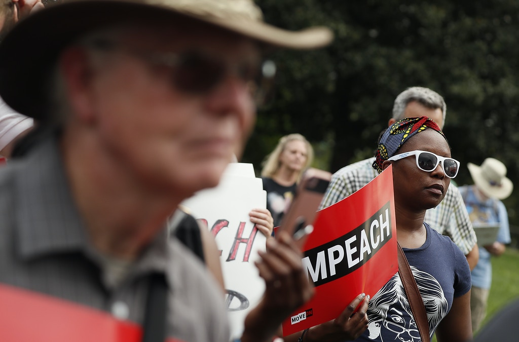 "WASHINGTON, DC - SEPTEMBER 26: Members of Congress and activists support an immediate inquiry towards articles of impeachment against U.S. President Donald Trump at the ""Impeachment Now!"" rally on the grounds of the U.S. Capital on September 26, 2019in Washington, D.C. (Photo by Paul Morigi/Getty Images for MoveOn Political Action)"