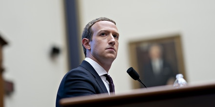 Mark Zuckerberg, chief executive officer and founder of Facebook Inc., listens during a House Financial Services Committee hearing in Washington, D.C., U.S., on Wednesday, Oct. 23, 2019. Zuckerberg struggled to convince Congress of the merits of the company's plans for a cryptocurrency in light of all the other challenges the company has failed to solve. Photographer: Andrew Harrer/Bloomberg via Getty Images