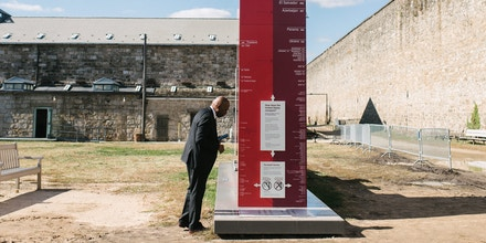 Norris Henderson reads a monument that stands at the Eastern State Penitentiary in Philadelphia, PA. on Monday, October 28, 2019. The monument illustrates how many people have been incarcerated every decade within the U.S. The U.S. has the largest incarcerated population in the world.Hannah Yoon for The Intercept