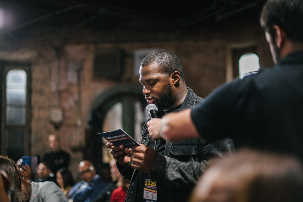 Josh Glenn of Philadelphia asks a question to Democratic presidential candidate Cory Booker during a presidential town hall moderated by formerly incarcerated people at the Eastern State Penitentiary in Philadelphia, PA. on Monday, October 28, 2019. Hannah Yoon for The Intercept