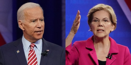 Democratic presidential candidates Joe Biden, left, and Sen. Elizabeth Warren at the Human Rights Campaign Foundation and CNN's presidential town hall focused on LGBTQ issues on Oct. 10, 2019 in Los Angeles.