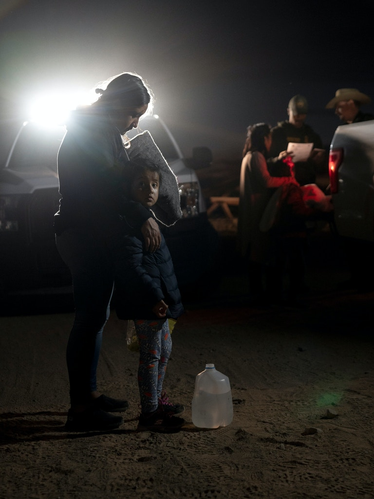 U.S. border patrol agents process a group of migrants and their children who have just been apprehended after crossing the U.S. - Mexico border in Organ Pipe Cactus National Monument on November 9, 2019.Photo by Kitra Cahana/MAPS for The Intercept