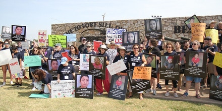Members of interfaith group Heartland for Human Justice gather at the entrance to Fort Sill in Lawton, Okla., on Aug. 1, 2019.