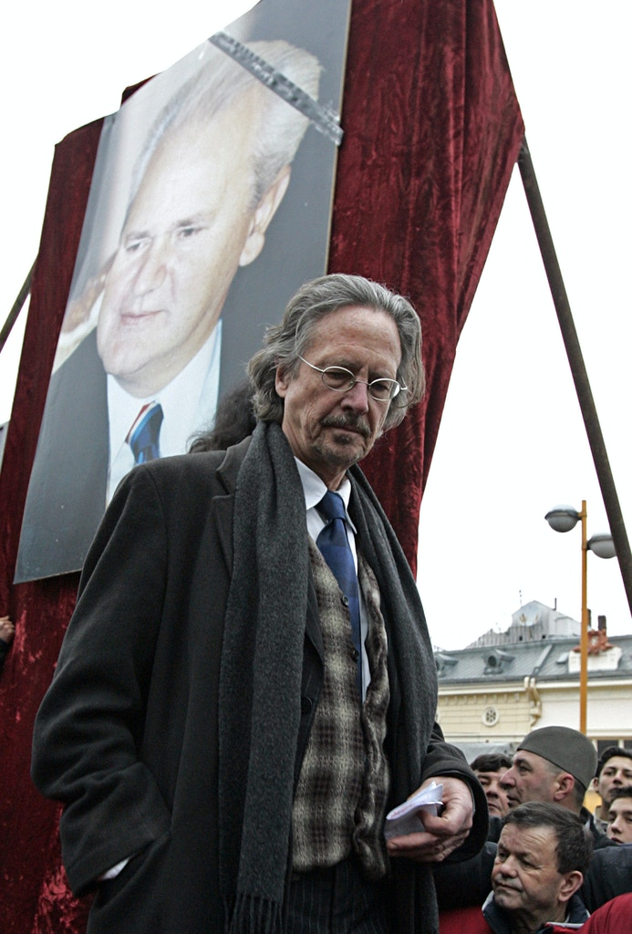 Austrian author Peter Handke is seen before his speech at the rally just before the funeral of late Serbian leader Slobodan Milosevic, in his native town of Pozarevac, some 50 kilometers (30 miles) southeast of Belgrade, Saturday, March 18, 2006. Milosevic died on March 11 in his prison cell in The Hague and was buried in the yard of his house in his hometown of Pozarevac.  (AP Photo/Petar Pavlovic)