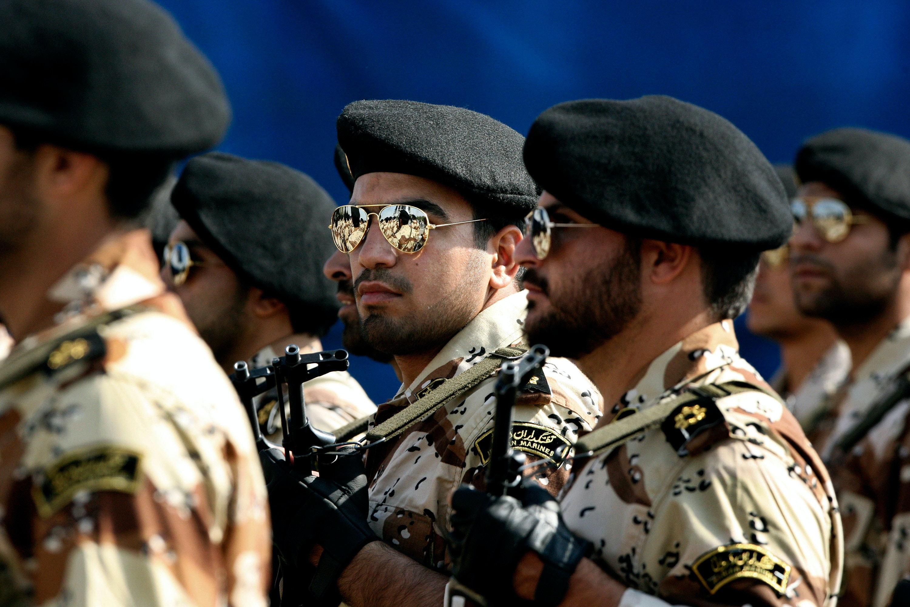 In this Sept. 22, 2011 photo, members of Iran's Revolutionary Guard march in front of the mausoleum of the late Iranian revolutionary founder Ayatollah Khomeini, just outside Tehran, Iran, during armed an forces parade marking the 31st anniversary of the start of the Iraq-Iran war. Among the many mysteries inside Iran's ruling hierarchy, the Quds Force, which sits atop the vast military and industrial network of the Revolutionary Guard, has a special place in the shadows. (AP Photo/Vahid Salemi)