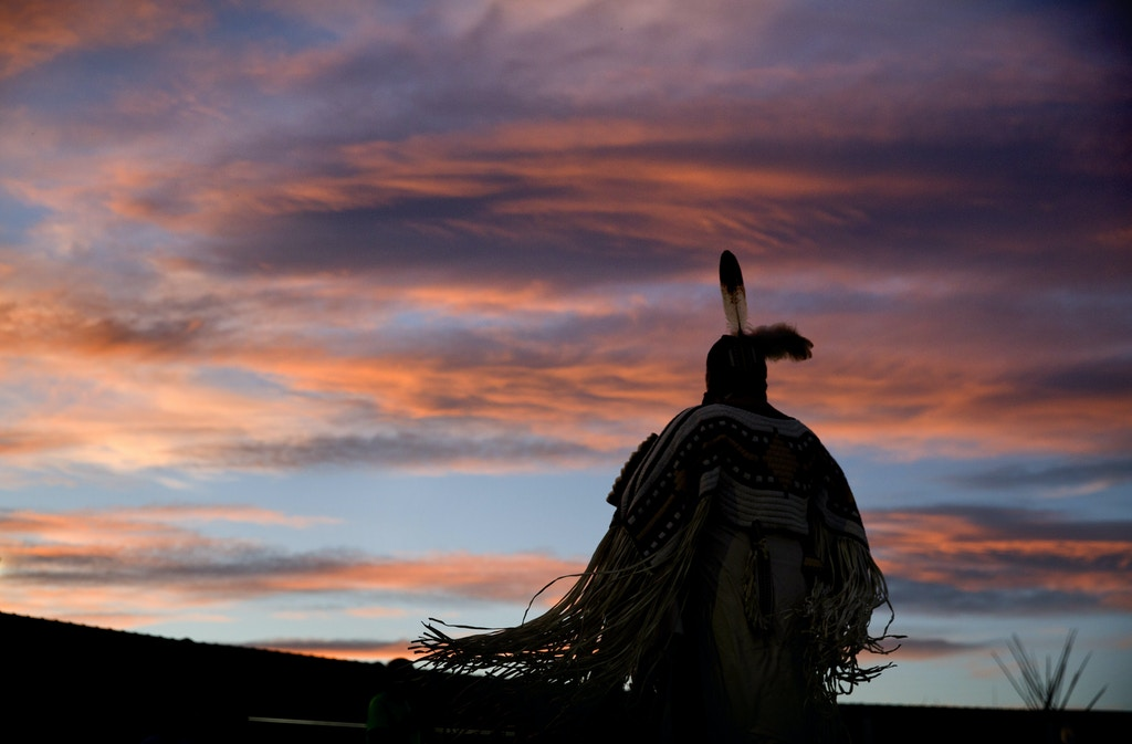 FILE--In this July 13, 2018, file photo, a woman performs a traditional Native American dance during the North American Indian Days celebration on the Blackfeet Indian Reservation in Browning, Mont. A study released by a Native American non-profit says numerous police departments in cities nationwide are not adequately identifying or reporting cases of missing and murdered indigenous women. (AP Photo/David Goldman, file)