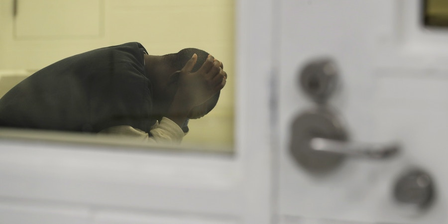 A detainee waits in a holding area during a media tour at the U.S. Immigration and Customs Enforcement (ICE) detention facility Tuesday, Sept. 10, 2019, in Tacoma, Wash. (AP Photo/Ted S. Warren)