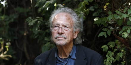 Austrian-born author Peter Handke sits in his garden at his house in Chaville near Paris, Thursday, Oct. 10, 2019. Handke was awarded the 2019 Nobel Prize in literature earlier Thursday. (AP Photo/Francois Mori)