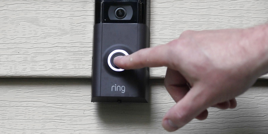 """FILE - In this July 16, 2019, file photo, Ernie Field pushes the doorbell on his Ring doorbell camera at his home in Wolcott, Conn. Amazon says it has considered adding facial recognition technology to its Ring doorbell cameras. The company said in a letter released Tuesday, Nov. 19 by U.S. Sen. Ed Markey that facial recognition is a """"contemplated, but unreleased feature"""" of its home security cameras. The Massachusetts Democrat wrote to Amazon CEO Jeff Bezos in September raising privacy and civil liberty concerns about Ring's video-sharing partnerships with hundreds of police departments around the country.   (AP Photo/Jessica Hill, File)"""