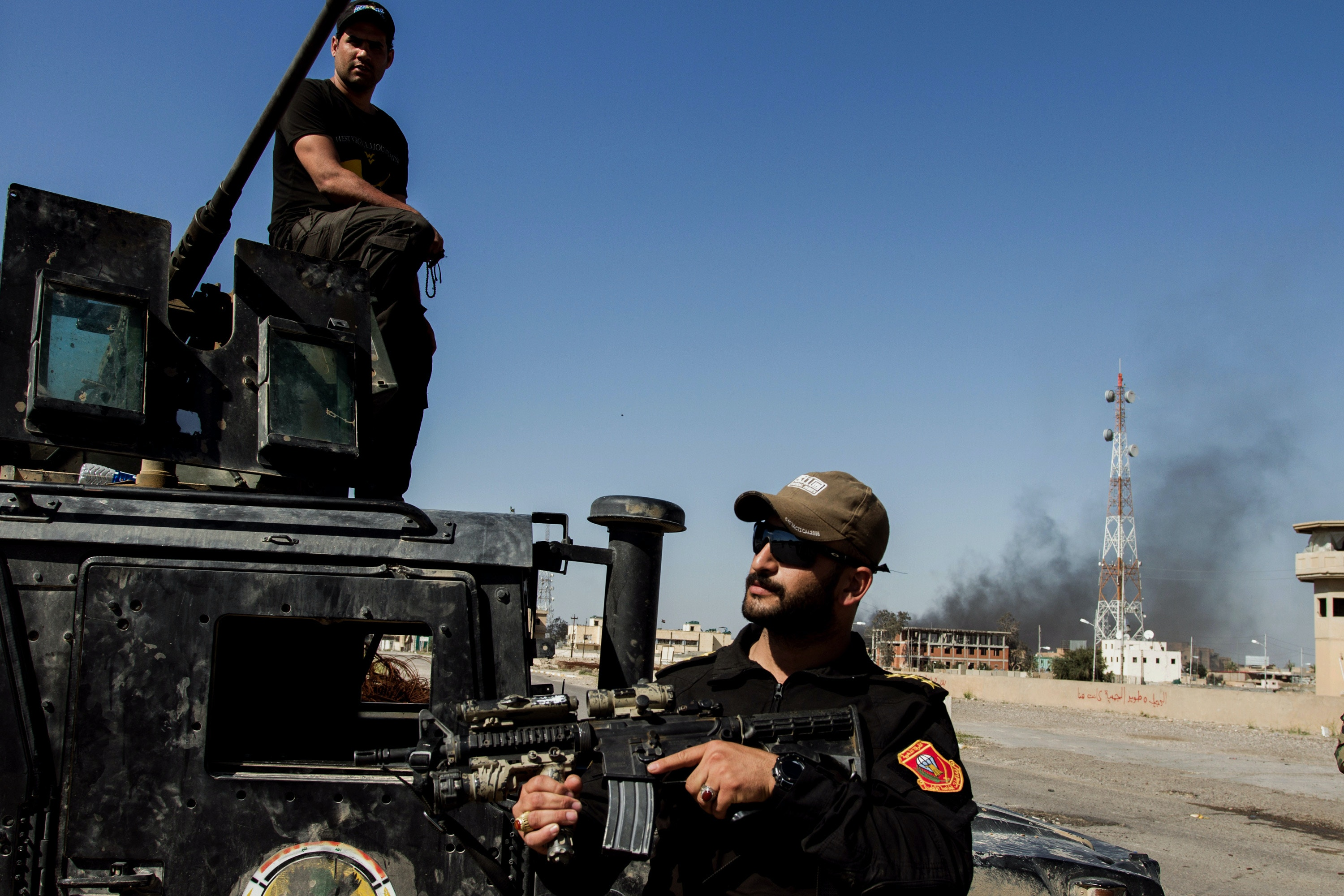 Shi'ite soldiers control the streets of Tirkit, where a few IS fighters are still entrenched, in Tirkit, Iraq, 05 April 2015. The majority of the city has been taken by Shi'ite mobilization forces Al-Hashd al-Shaabi after having been controlled by the IS militia since June 2014. Photo by: Sebastian Backhaus/picture-alliance/dpa/AP Images