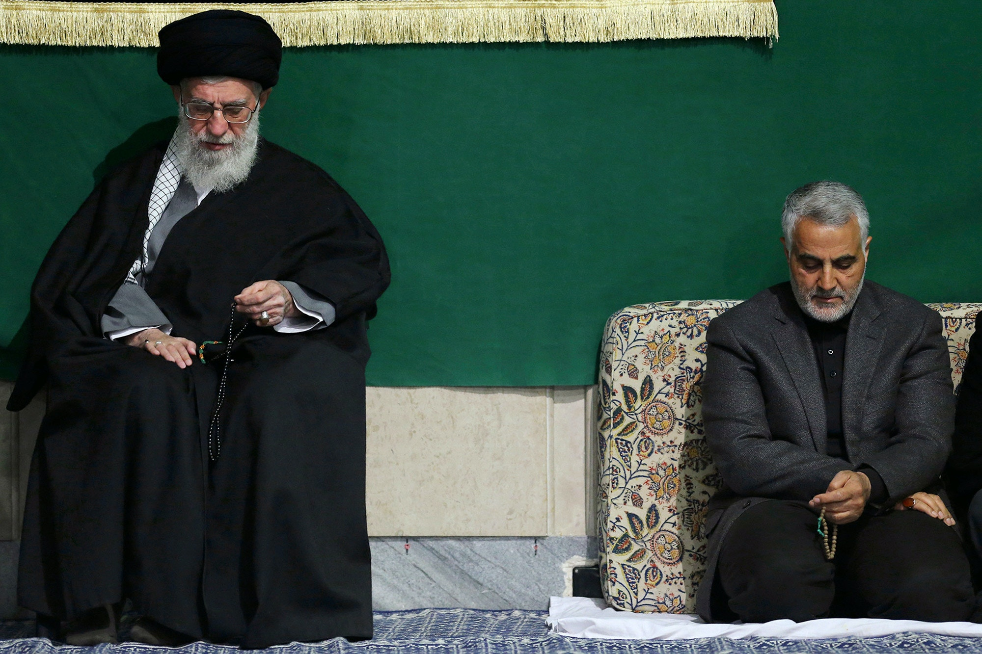 In this photo released by an official website of the office of the Iranian supreme leader, commander of Iran's Quds Force, Qassem Soleimani, right, sits next to the Supreme Leader Ayatollah Ali Khamenei while attending a religious ceremony in a mosque at his residence in Tehran, Iran, Friday, March 27, 2015. Iran's Foreign Minister Mohammad Javad Zarif sought Friday to reassure the six world powers conducting nuclear power talks in Switzerland, saying the negotiations remained focused on sealing a deal. (AP Photo/Office of the Iranian Supreme Leader)