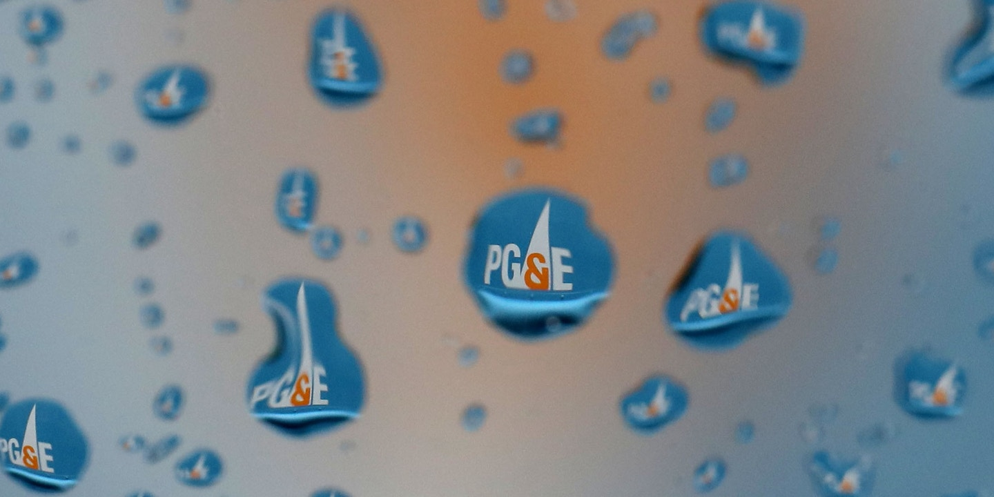 SAN FRANCISCO, CALIFORNIA - JANUARY 15: The Pacific Gas & Electric (PG&E) logo on a truck is visible through raindrops on a window on January 15, 2019 in San Francisco, California. PG&E announced that they are preparing to file for bankruptcy at the end of January as they face an estimated $30 billion in legal claims for electrical equipment that might have been responsible for igniting destructive wildfires in California. (Photo by Justin Sullivan/Getty Images)