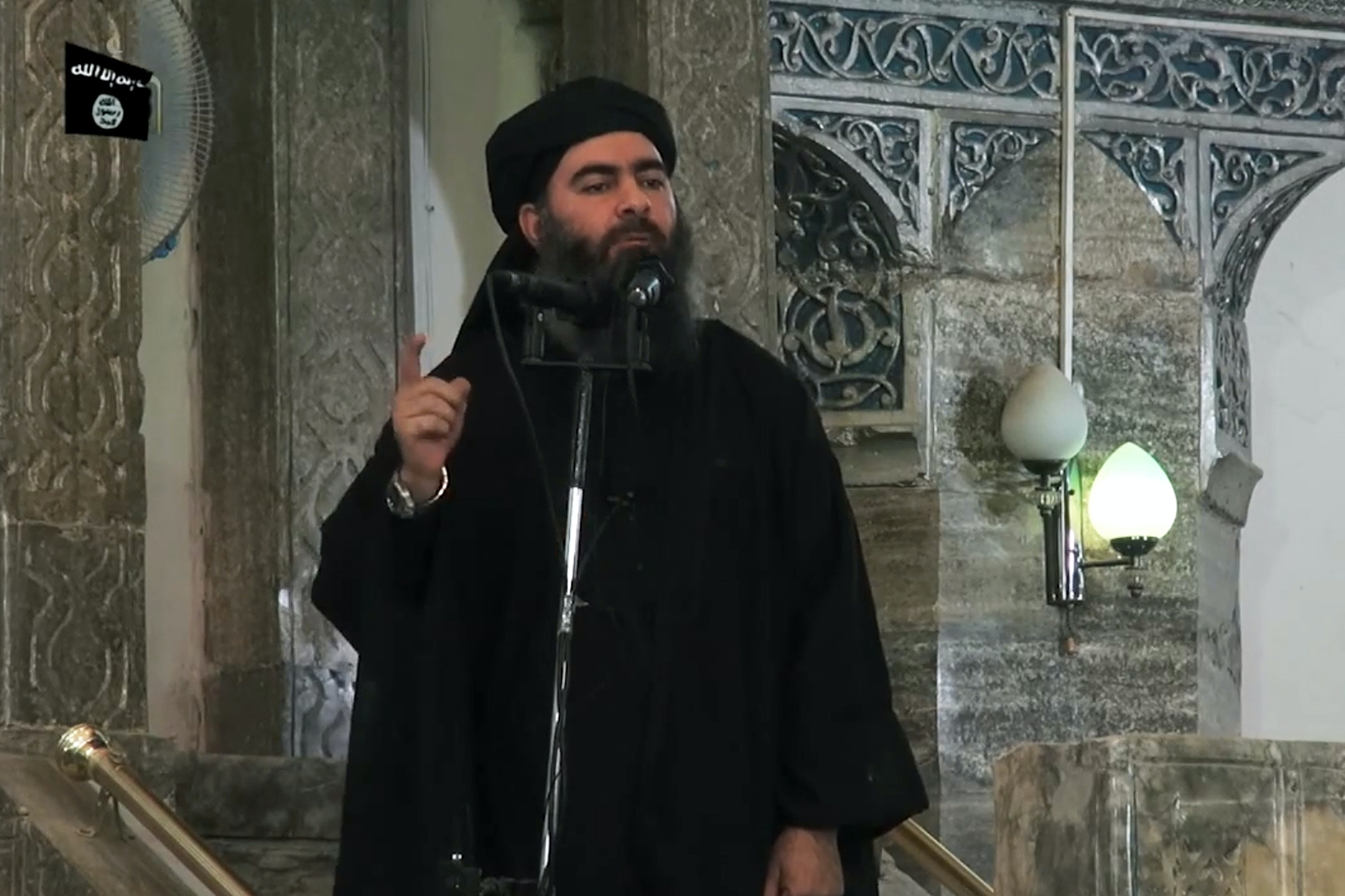 In this file picture taqken on July 5, 2014, an image grab taken from a propaganda video released by al-Furqan Media allegedly shows the leader of the Islamic State (IS) jihadist group, Abu Bakr al-Baghdadi, aka Caliph Ibrahim, adressing Muslim worshippers at a mosque in the militant-held northern Iraqi city of Mosul. (Photo by - / AFP)        (Photo credit should read -/AFP via Getty Images)