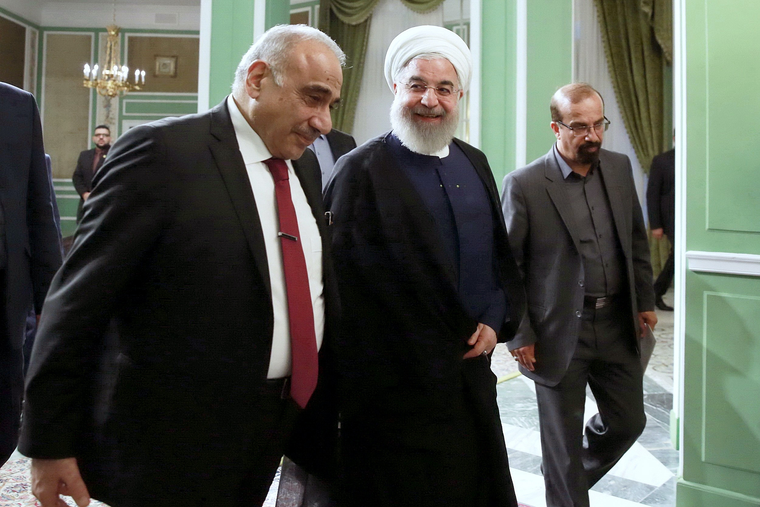 TEHRAN, IRAN - JULY 22: Iraqi Prime Minister Adil Abdul-Mahdi (L) meets with Iranian President Hassan Rouhani (C) as part of his visit in Tehran, Iran on July 22, 2019. (Photo by Iranian Presidency/Handout/Anadolu Agency via Getty Images)