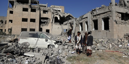 DHAMAR PROVINCE, YEMEN - SEPTEMBER 01: People inspect buildings destroyed by airstrikes, carried out by warplanes of the Saudi-led coalition, targeted a prison killing more than 50 and injured other tens on September 01, 2019 in Dhamar province in Yemen. At least 50 were killed and scores more injured, though emergency personnel at the scene say the death toll may be much higher, according to published reports.  (Photo by Mohammed Hamoud/Getty Images)