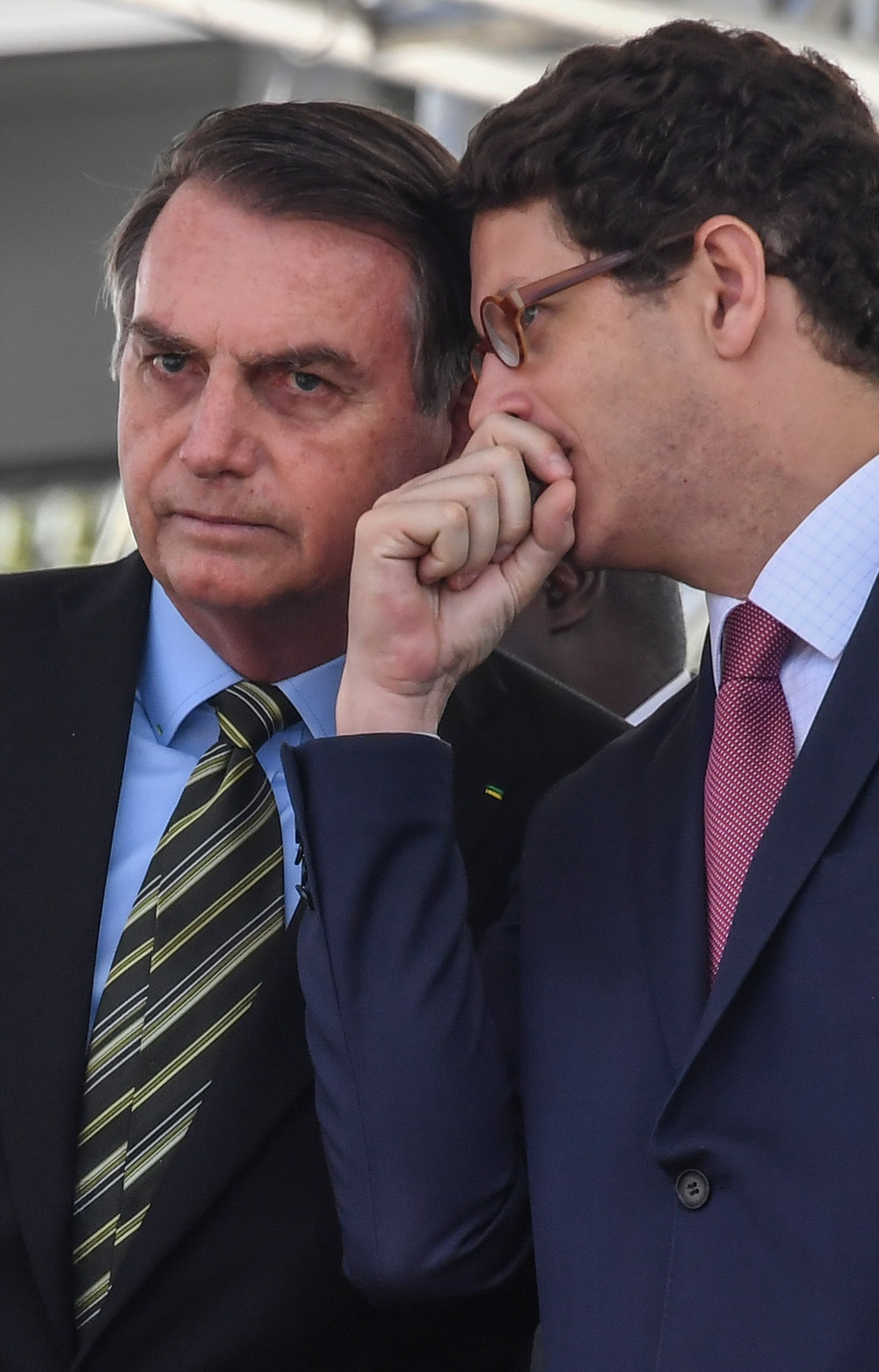 Brazilian President Jair Bolsonaro (L) listens to his Minister of the Environment Ricardo Salles, during a military event in Sao Paulo, Brazil on October 11, 2019.