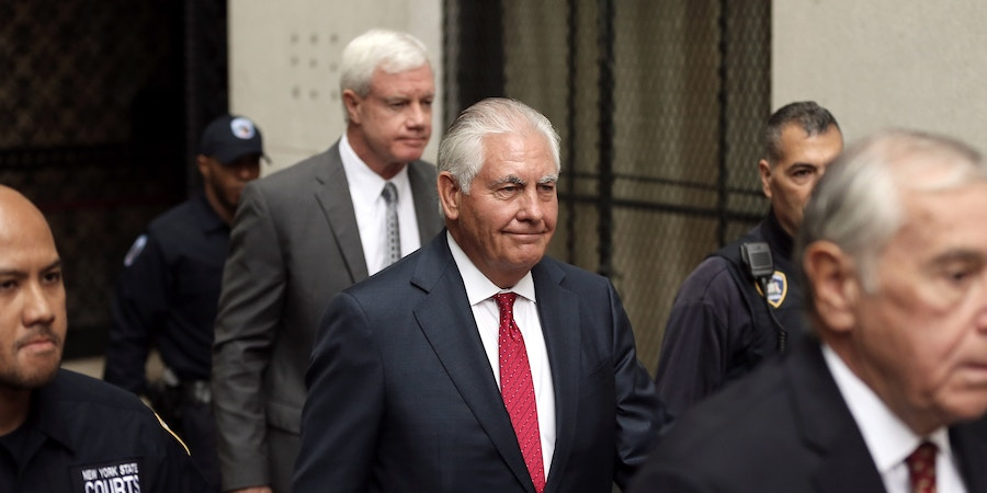 Rex Tillerson, former chief executive officer of Exxon Mobil Corp., center, departs from state court in New York, U.S., on Wednesday, Oct. 30, 2019. Tillersontestified Wednesday in New York's securities-fraud trial over the oil giant's climate-change disclosures, adding an element of drama to proceedings that have had few fireworks so far. Photographer: Peter Foley/Bloomberg via Getty Images