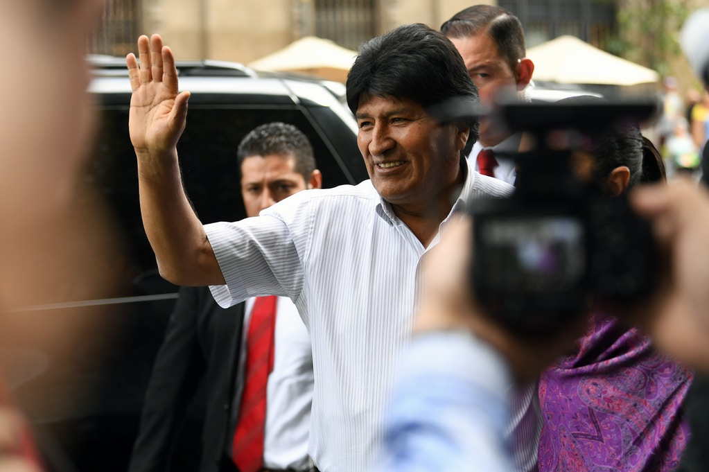 Bolivian ex-President Evo Morales waves upon arrival at the Historic City Hall, where Mexico City's Mayor Claudia Sheinbaum will honor him as Distinguished Guest, on November 13, 2019 in Mexico City. - Morales arrived on the eve in Mexico -which granted him political asylum- after resigning amid growing unrest triggered by his controversial re-election to a fourth term. (Photo by PEDRO PARDO / AFP) (Photo by PEDRO PARDO/AFP via Getty Images)