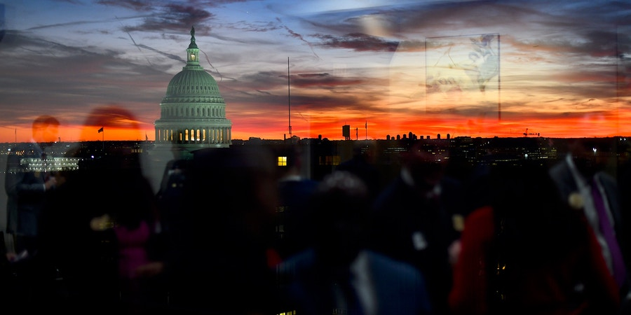 WASHINGTON, DC - NOVEMBER 13: Congressional staff are reflected as the sun sets behind the U.S. Capitol Building on November 13, 2019 in Washington, DC. In the first public impeachment hearings in more than two decades, House Democrats are trying to build a case that President Donald Trump committed extortion, bribery or coercion by trying to enlist Ukraine to investigate his political rival in exchange for military aide and a White House meeting that Ukraine President Volodymyr Zelensky sought with Trump. (Photo by Mark Makela/Getty Images)