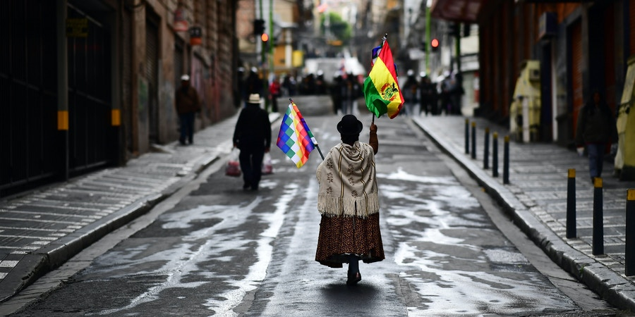 Supporters of Bolivian ex-President Evo Morales demonstrate in La Paz on November 14, 2019. - Bolivia's exiled former president Evo Morales said Wednesday he was ready to return to