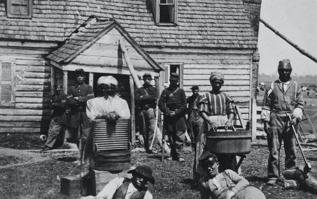 Escaped slaves working as washerwomen at a Union general's headquarters. Escaped slaves were referred to as 'contrabands' an expression coined by General Benjamin F. Butler. They were considered spoils of war and were often forced to work for the army for little or no compensation. Others were allowed to find civilian work, while later in the war the men were encouraged to join black regiments, Contraband was a term commonly used in the United States military during the American Civil War to describe a new status for certain escaped slaves or those who affiliated with Union forces. The Army (and the United States Congress) determined that the US would not return escaped slaves who went to Union lines and classified them as contraband. They used many as laborers to support Union efforts and soon began to pay them wages.. (Photo by Matthew Brady/Buyenlarge/Getty Images)