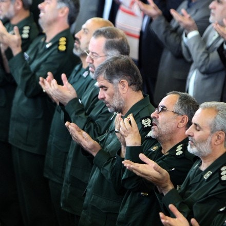 Senior members of Iran's Revolutionary Guards (C) attend the weekly Friday prayer at Tehran University 02 November 2007. Rafsanjani warned Iran to be alert in the face of