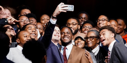U.S. Democratic presidential candidate Pete Buttigieg takes a selfie with attendees following his visit to Morehouse College in Atlanta, Georgia, U.S. November 18, 2019. REUTERS/Elijah Nouvelage - RC21ED9F5K00