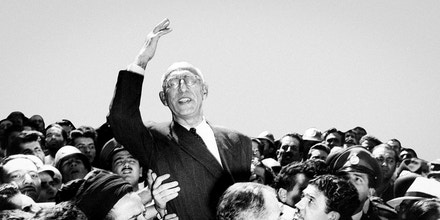 Prime Minister Mohammed Mosaddegh rides on the shoulders of cheering crowds in Tehran's Majlis Square, outside the parliament building, after reiterating his oil nationalization views to his supporters on Sept. 27, 1951.