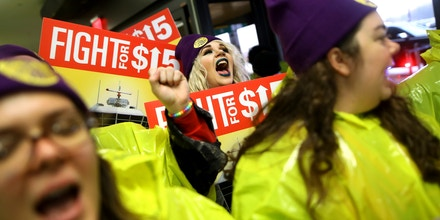 Workers protest for a raise in the minimum wage, at Newark Liberty International Airport in Newark, N.J., Nov. 29, 2016. Thousands of low-wage workers protested in cities across the U.S. on Tuesday to demand a $15-an-hour minimum wage and the right to form a union, shutting down streets and disrupting service at some of the nation's busiest airports. (Chang W. Lee/The New York Times)
