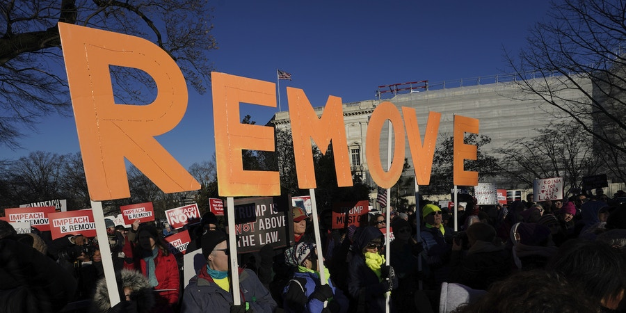 WASHINGTON, DC - DECEMBER 18: Protesters supporting the impeachment of U.S. President Donald Trump gather outside the U.S. Capitol December 18, 2019 in Washington, DC. Later today the U.S. House of Representatives is expected to vote on two articles of impeachment against Trump charging him with abuse of power and obstruction of Congress. (Photo by Win McNamee/Getty Images)