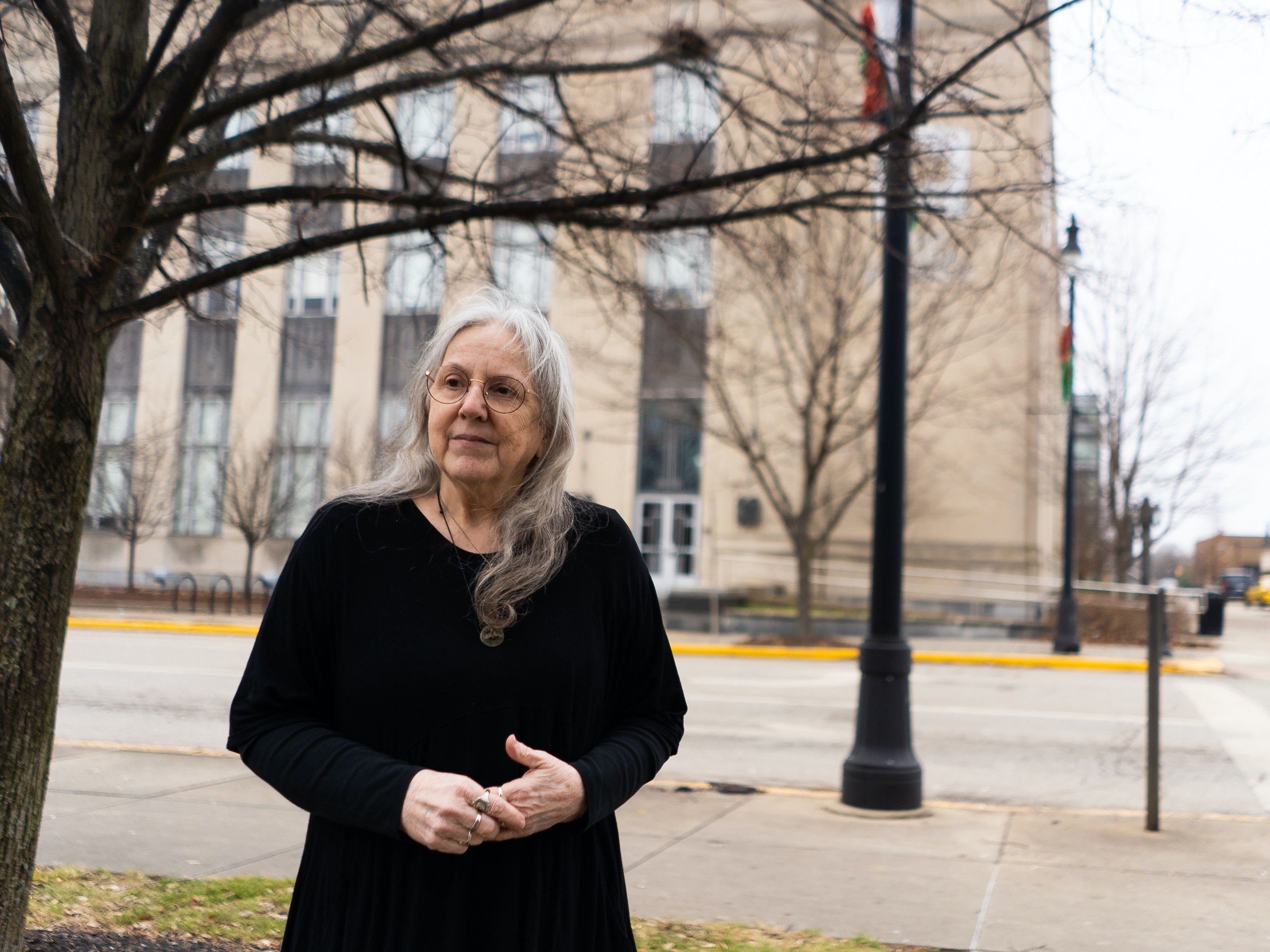 Zann Carter, a Terre Haute resident, is a leader in the community when it comes to advocacy and activism against the death penalty. Here, she is photographed in front of the original Federal Building, which was turned over to Indiana State University in 2007. in Terre Haute, Ind., on Friday, Dec. 27, 2019. The corner behind Carter was the location of much of the protests and demonstrations held against the death penalty. The United States Penitentiary, Terre Haute, in Terre Haute, Ind., was designated on July 19, 1993, by the federal government as the location at which federal death sentences would be carried out on. As of Friday, Dec. 27, 2019, three executions have taken place, with several currently scheduled. Photo by Lucas Carter / www.lucascarter.com.