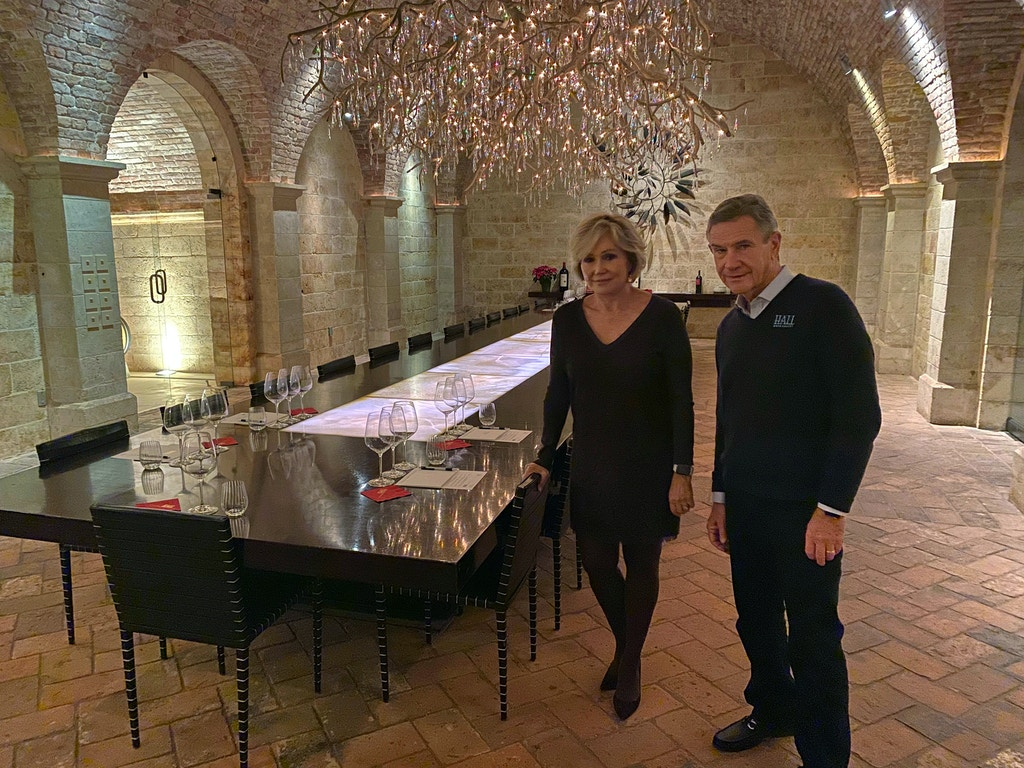 "Kathryn and Craig Hall, owners of Hall Rutherford Winery, stand inside the ""wine cave"" dining room where they held a fundraising dinner for Democratic presidential candidate Pete Buttigieg, Friday, Dec. 20, 2019, in Rutherford, Calif.  They say their most expensive bottle of wine costs $350 and wasn't served at the fundraiser. (AP Photo/Terence Chea)"