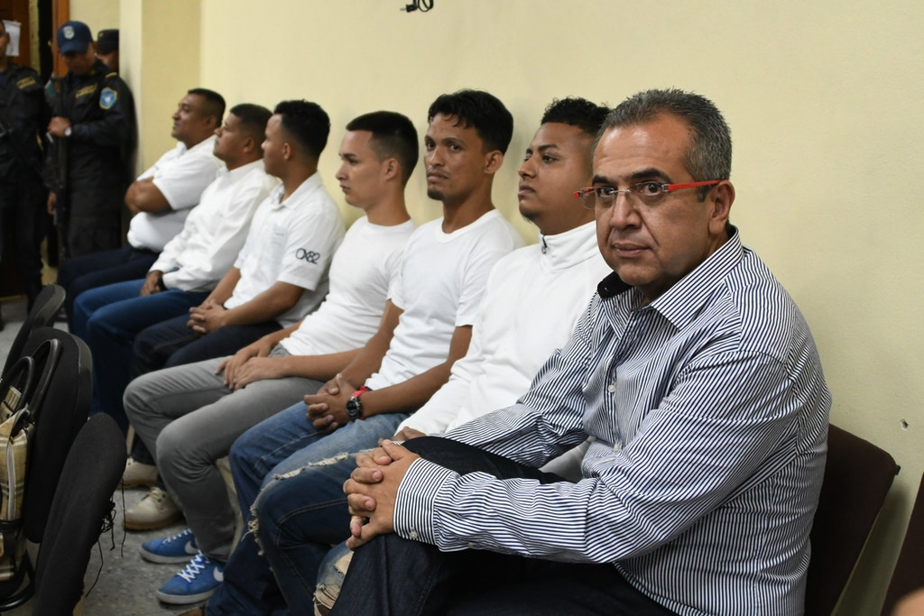 This photo taken on September 17, 2018 shows Sergio Rodriguez (R) along with six other accused on the murder of indigenous environmental activist Berta Caceres, after the judges suspended the trial following the filing of a court challenge in Tegucigalpa. - Berta Caceres' family, is expecting on November 22, 2018 that next week seven of nine accused in the activist murder will be sentenced, yet they will continue seeking for justice on the responsibility of the intellectual authors. (Photo by ORLANDO SIERRA / AFP)        (Photo credit should read ORLANDO SIERRA/AFP via Getty Images)