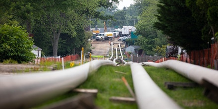 EXTON, PENNSYLVANIA - JUNE 5: Sections of steel pipe lie in a staging area before being inserted underground as part of the ETP-Sunoco Mariner East 2 pipeline in the Marchwood neighborhood of Exton, Pennsylvania on June 5, 2019. Once completed, the 350-mile Mariner East 2 pipeline will carry 275,000 gallons per day of  liquid natural gas by-products from the Marcellus Shale and stretch across Pennsylvania ending at Marcus Hook, Delaware where the petroleum products will be exported to other states and overseas. (Photo by Robert Nickelsberg/Getty Images)
