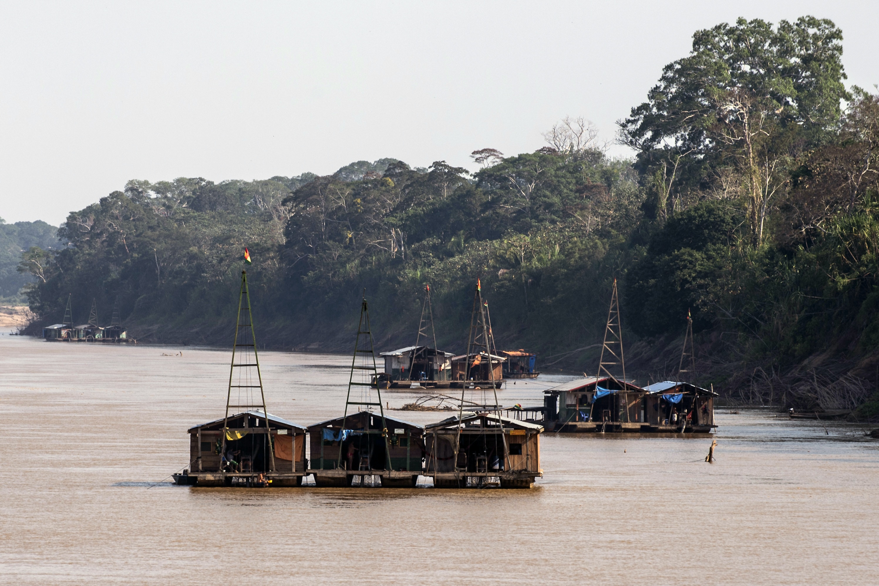 View of dredgers at the Madre de Dios River in Tacana indigenous territory, near Las Mercedes, La Paz department, Bolivia on August 31, 2019. - The Tacana indigenous community is worried about mining activities taking place in their reserve, but even more about an exploitation project launched by the government, which seeks to extract 50 million barrels of oil and 125 billion cubic feet of gas from their subsoil. (Photo by ERNESTO BENAVIDES / AFP) (Photo by ERNESTO BENAVIDES/AFP via Getty Images)