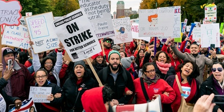 Striking teachers, school staff, and supporters march through downtown Chicago on the ninth day of the Chicago Teachers Union strike on October 25, 2019. (Photo by Max Herman/NurPhoto via Getty Images)